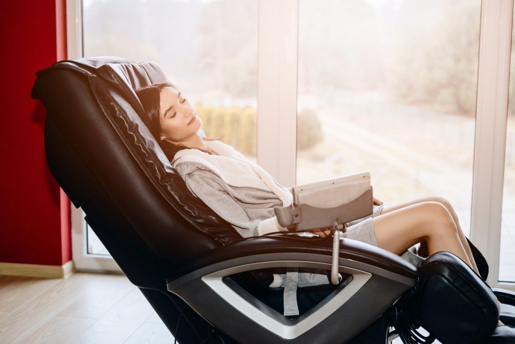 Massage Chair Used by a Woman